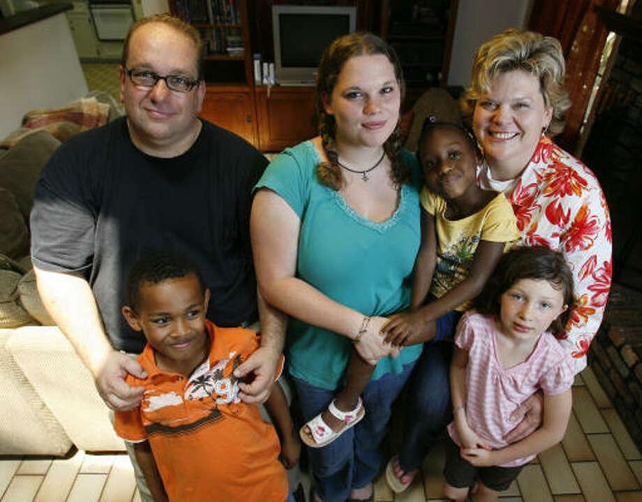 The Clark family, from top left, Cody Clark; Hannah, 17, holding Olivia, 5; Heidi Clark;  Aaron, 9; and Mary Grace, 7. Photo: Karen Warren, Houston Chronicle
