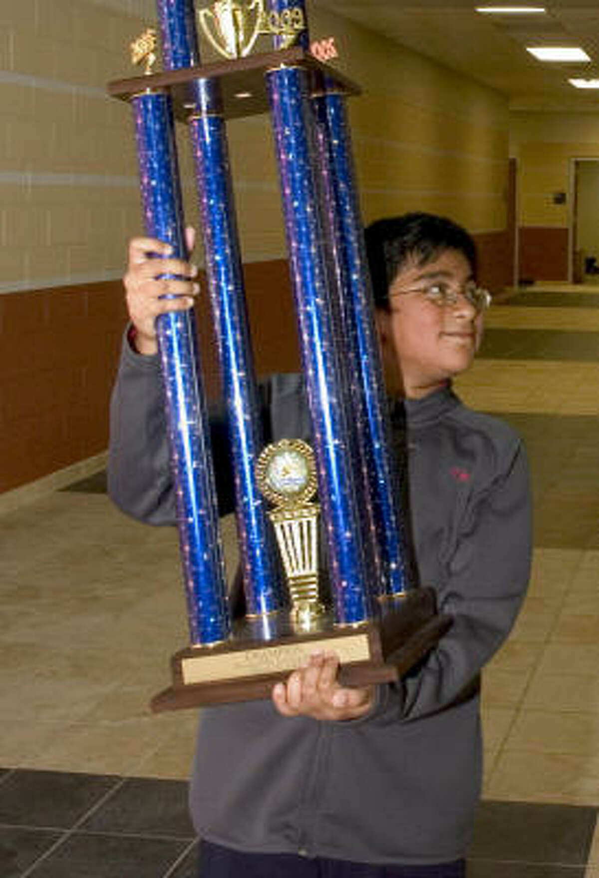 Aditya Chemudupaty shows off his trophy last month after his win in Pearland.