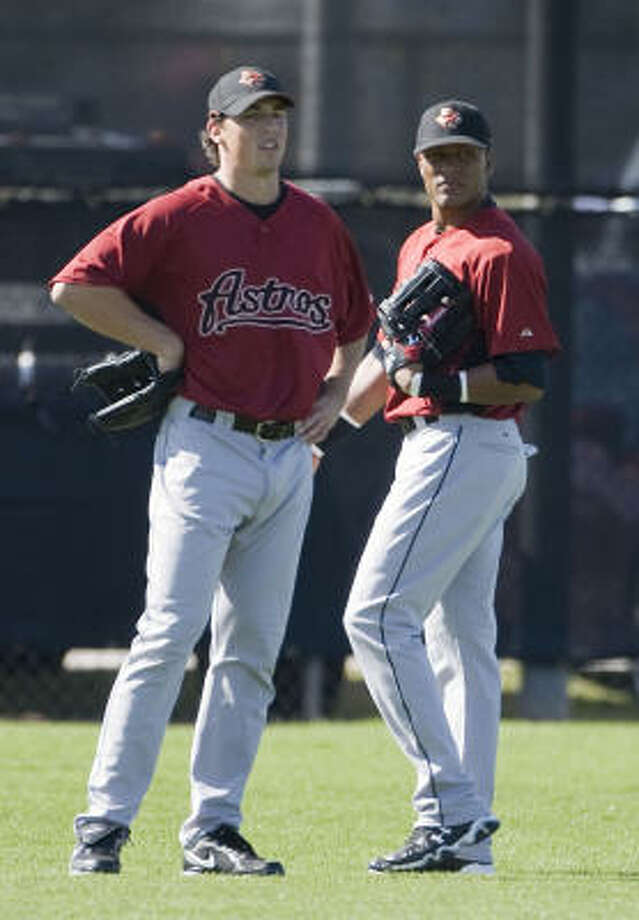Brian Bogusevic, left, shown alongside Yordany Ramirez at Astros camp in Kissimmee, Fla. Photo: James Nielsen, Chronicle