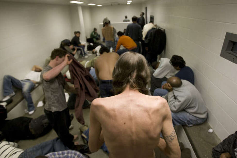 A state agency said last week that crowding in holding cells such as the one here had been remedied, but the Harris County Jail remains over design capacity. Photo: Johnny Hanson, Chronicle