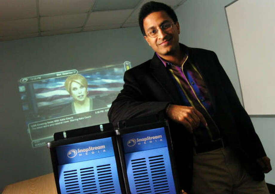 Rakesh Agrawal, president and CEO of SnapStream Media, shows the DVR servers he and his team developed to help media efficiently pull video clips. Producers for The Daily Show and The Colbert Report will use the technology. Photo: Chris Curry :, For The Chronicle