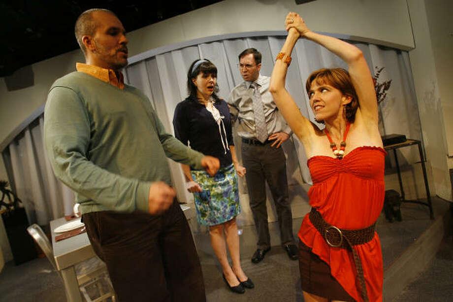 "Troy Schulze, Charlesanne Rabensburg, Greg Dean, and Amy Bruce,star in ""Hunter Gatherers,"" a dark comedy by Peter Sinn Nachtrieb. Photo: MAYRA BELTRAN :, CHRONICLE"