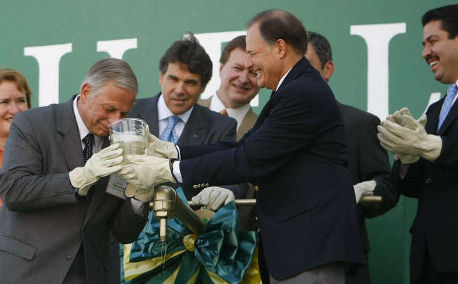 At the grand opening of GreenHunter's biodiesel plant in Houston a year ago, U.S. Rep. Gene Green smells a biofuel sample while now-former U.S. Rep. Nick Lampson helps hold the jar. Looking on are Harris County Precinct 2 Commissioner Sylvia R. Garcia; Texas Gov. Rick Perry; Gary C. Evans, GreenHunter chairman and CEO; Deputy Energy Secretary Jeff Kupfer and then Houston City Councilman Adrian Garcia. Photo: Mayra Beltran, Houston Chronicle