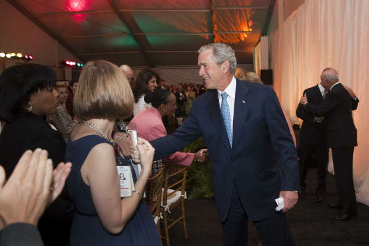 Former President George W. Bush greets the crowd at the Baylor International Pediatric AIDS Initiative dinner.