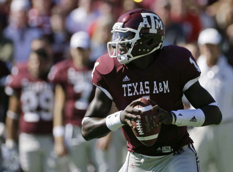 A&M quarterback Jerrod Johnson threw a school single-season record 21 touchdown passes last season. Photo: Matt Slocum, AP