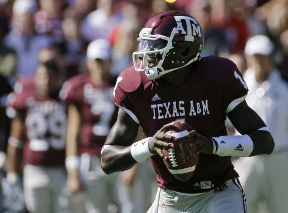A&M quarterback Jerrod Johnson threw a school single-season record 21 touchdown passes last season. Photo: Matt Slocum, AP