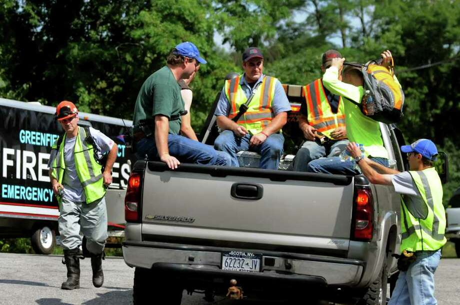 Volunteers and emergency personnel load into a truck to search for a missing sailor on Friday, Aug. 5, 2011, at the Rock City Falls Fire Station in Rock City Falls, N.Y. (Cindy Schultz / Times Union) Photo: Cindy Schultz