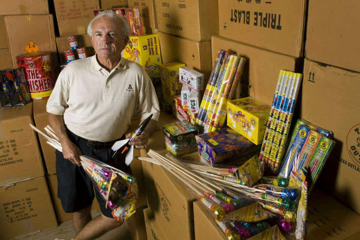 Texas' fireworks laws have become contentious. Here Paul Dewey Jones poses at his store last week.
