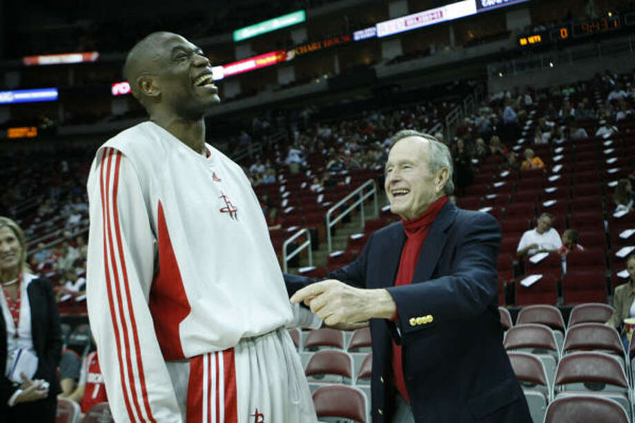 Dikembe Mutombo has a laugh with former President George H.W. Bush in March 2008. He was acknowledged by Bush at the 2007 State of the Union Address for his work in support of African causes. Photo: Nick De La Torre, Chronicle