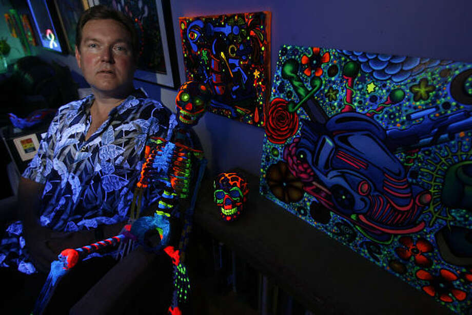 "Jeff Reese used to smuggle canvases into his job at the Harris County Jail and paint while he guarded prisoners. The results, which he signs ""Solomon Kane,"" are psychedelic, groovy paintings you'd have seen under black lights during the Sgt. Pepper era.  Photo: MAYRA BELTRÁN, Chronicle"