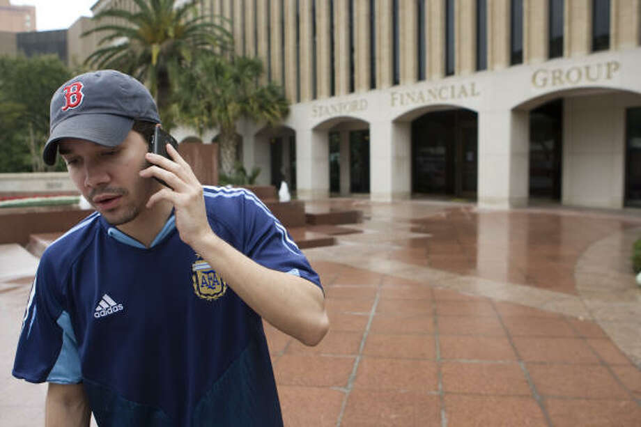 Rodolfo Soules tried to close a friend's account at Stanford Financial Group Wednesday, but the building was closed. Photo: Brett Coomer, Chronicle
