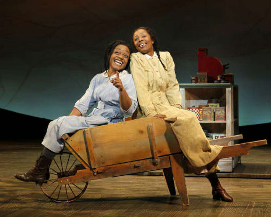 American Idolalum LaToya London, right, stars as Nettie, and Kenita Miller plays her sister Celie in the national tour of The Color Purple. Photo: Paul Kolnik