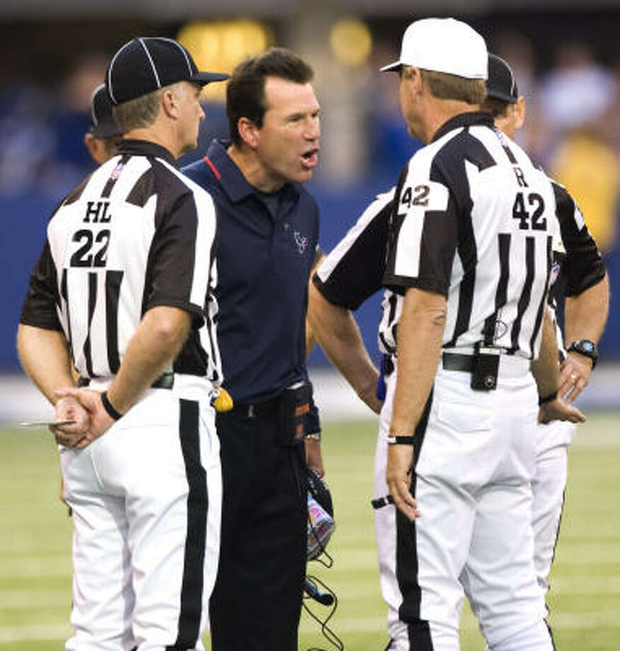 Texans head coach Gary Kubiak argues with the officials on a replay that gave the Colts the ball after a Ryan Moats fumble near the goal line. Photo: Brett Coomer, Chronicle