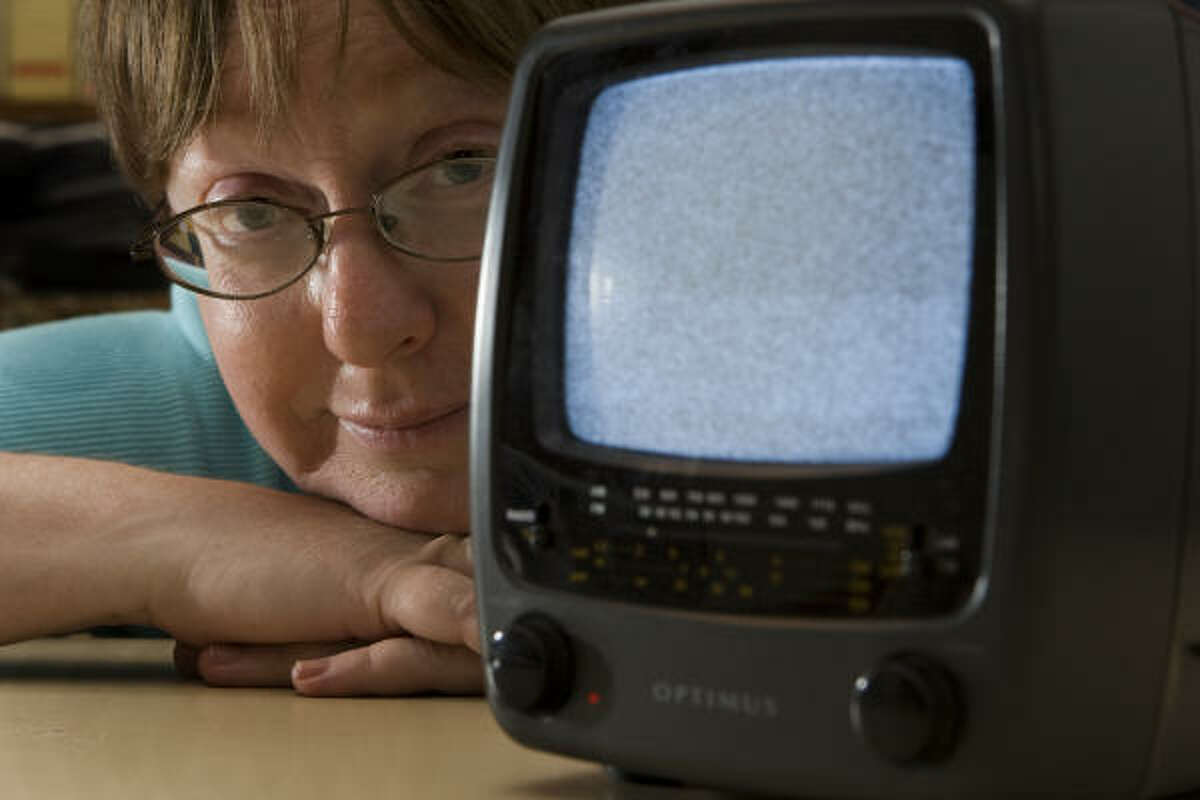Donna Clanton's battery-powered set is among the many analog TVs no longer getting signals. Digital sets and battery-powered converters are available, for a price.