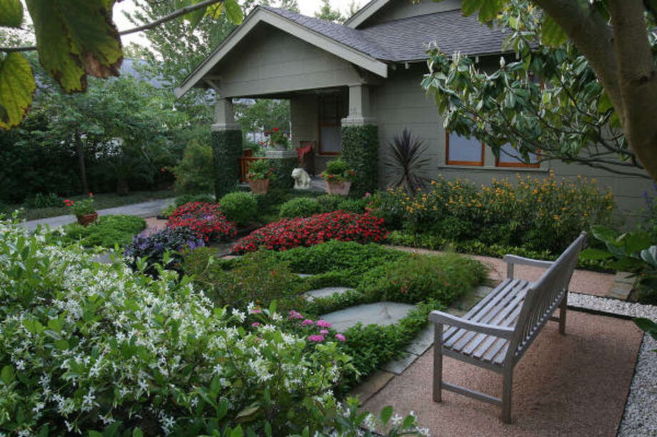 David Morello's Heights home lies between lush gardens with granite and stone pathways that shape the garden with varying 'hardscapes.' Behind David Morello's bungalow gardens | Molly Glentzer's Digging In blog | Houston Plant Database  | HoustonGrows.com Photo: Mayra Beltran, Chronicle