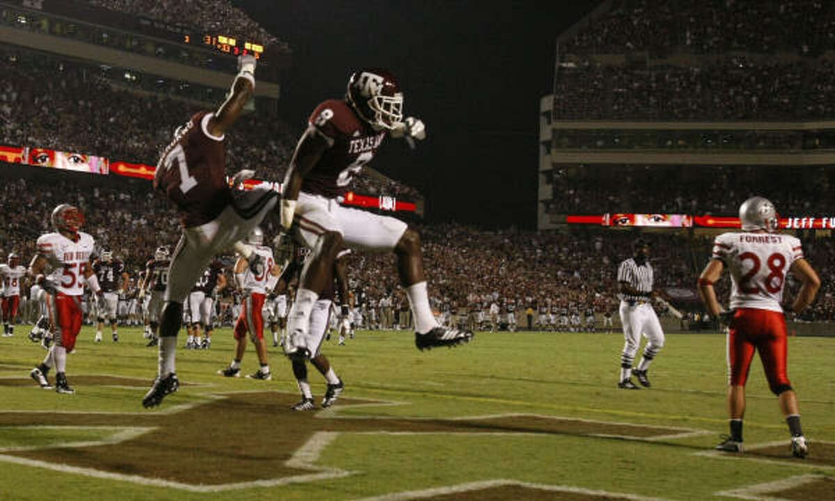 Uzoma Nwachukwu, left, and Jeff Fuller celebrate Fuller's touchdown reception in the third quarter.