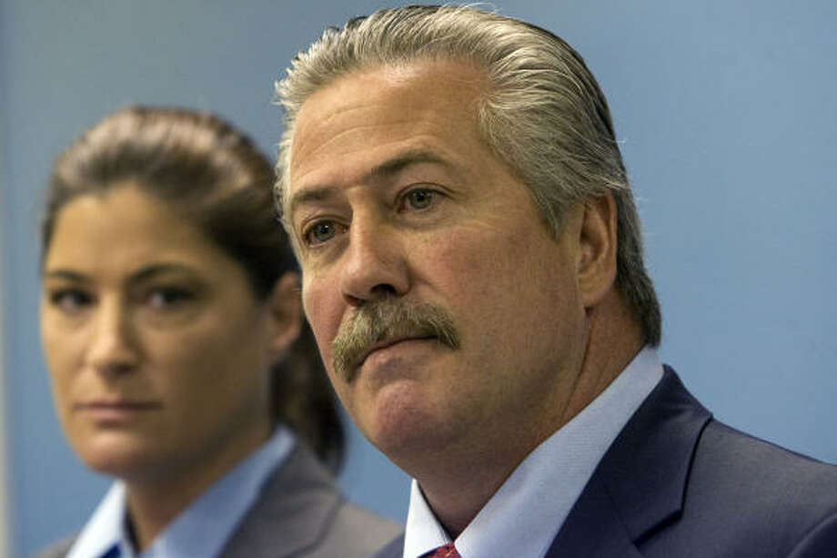 Houston Arson Bureau chief investigator Alison Stein, left, and Robert Elder, assistant special agent in charge of the Bureau of Alcohol, Tobacco and Firearms office in Houston, reported during a press conference that the massive fire that destroyed the warehouse at Gallery Furniture on the North Freeway was intentionally set. Photo: Johnny Hanson, Chronicle