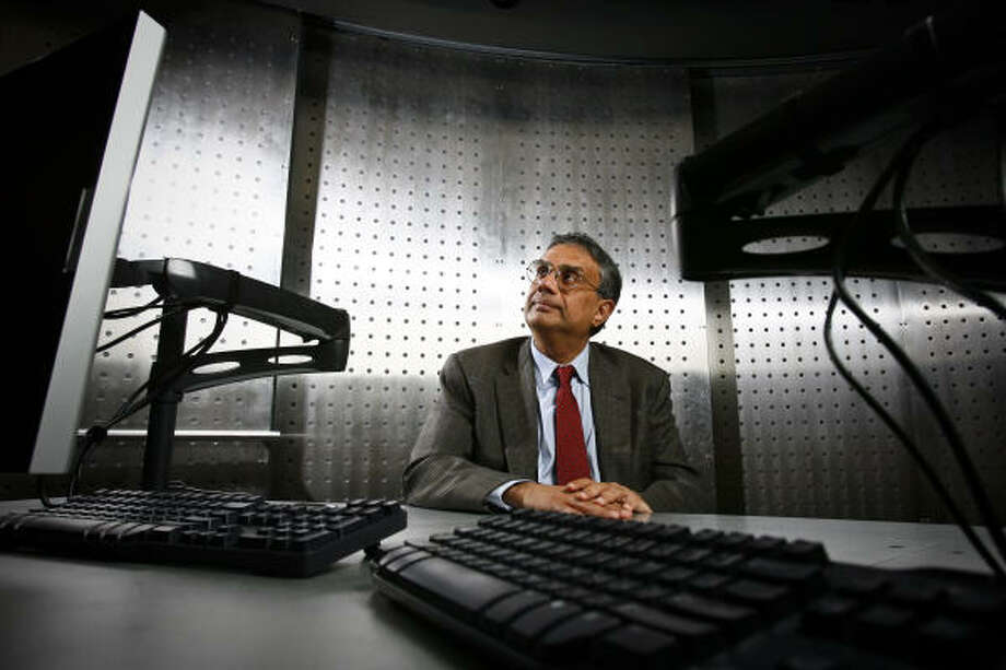 Rice University professor Krishna Palem created a microchip that uses 30 times less electricity while running seven times faster than today's technology. Photo: Michael Paulsen, Chronicle