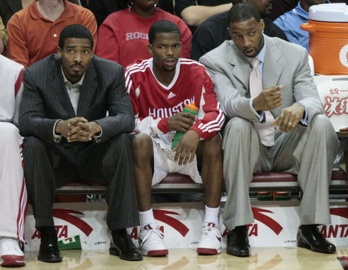 Rockets guard Tracy McGrady, far right, sat out Wednesday's game with the Kings for precautionary reasons despite the team basically telling him he's not injured, Jerome Solomon writes.