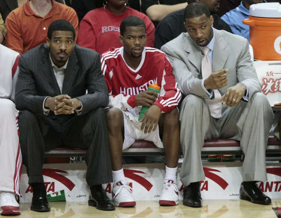 Rockets guard Tracy McGrady, far right, sat out Wednesday's game with the Kings for precautionary reasons despite the team basically telling him he's not injured, Jerome Solomon writes. Photo: Billy Smith II, Chronicle
