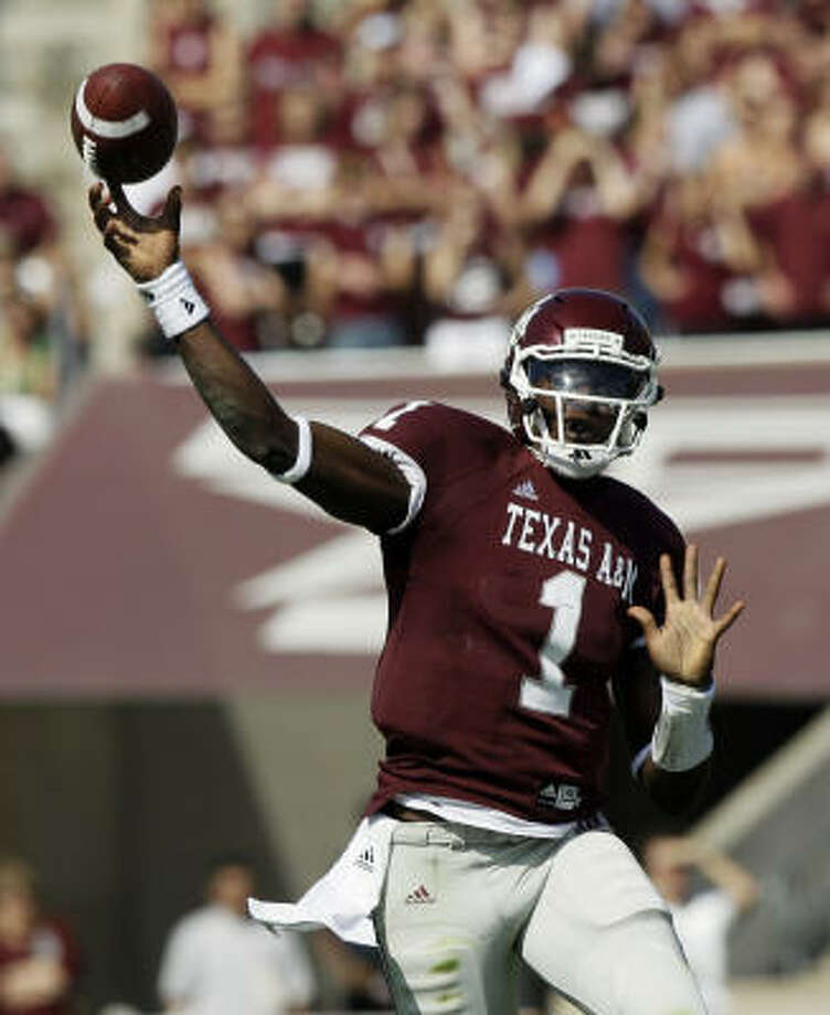 Texas A&M quarterback Jerrod Johnson enters spring camp as the hunted with Ryan Tannehill as the hunter. Photo: David J. Phillip, AP