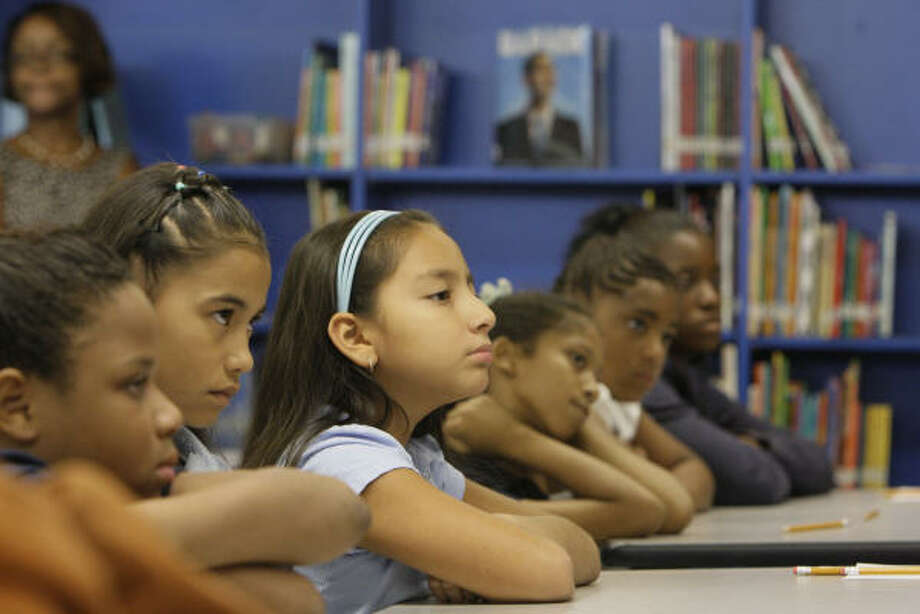 Frost Elementary School students gathered Tuesday in the campus library for the televised speech by President Barack Obama. From left are Alexandria Bibbins, Kimberlin Abeja, Leslie Pineda, Mia Green, Deaundrea Cooper and Kiposha Williams. Photo: Melissa Phillip, Chronicle