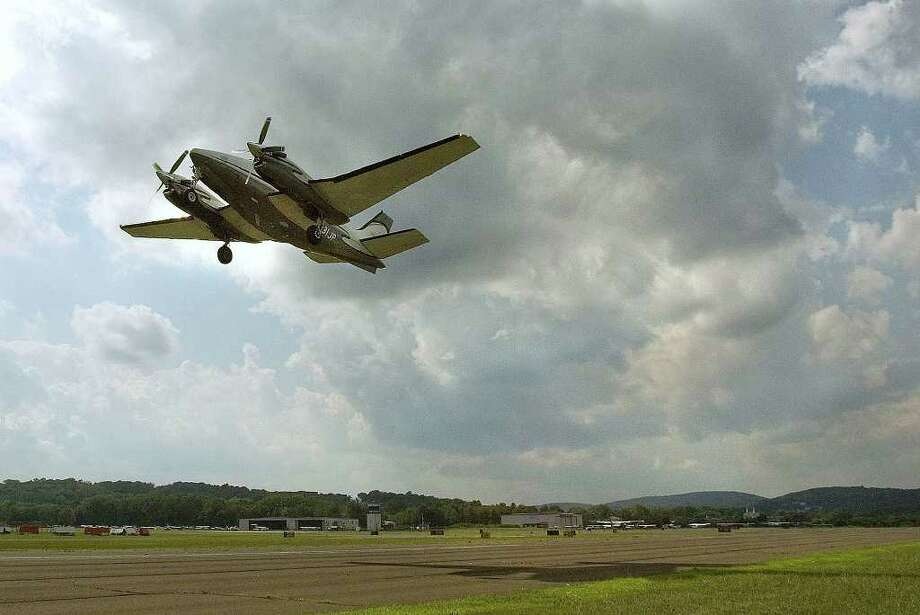 An airplane takes off at Danbury Municipal Airport on Friday, Aug. 5, 2011. Photo: Jason Rearick