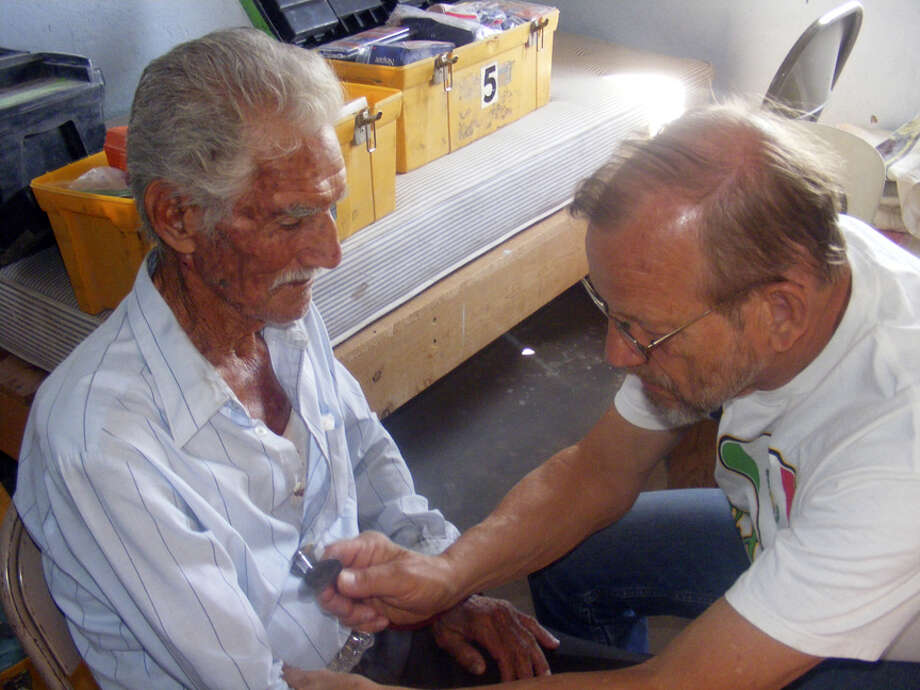 Dr. Ottis Layne examines a patient in April during a trip organized by Mision De Candelilla to a Mexican village south of the Big Bend. Photo: Courtesy Photo