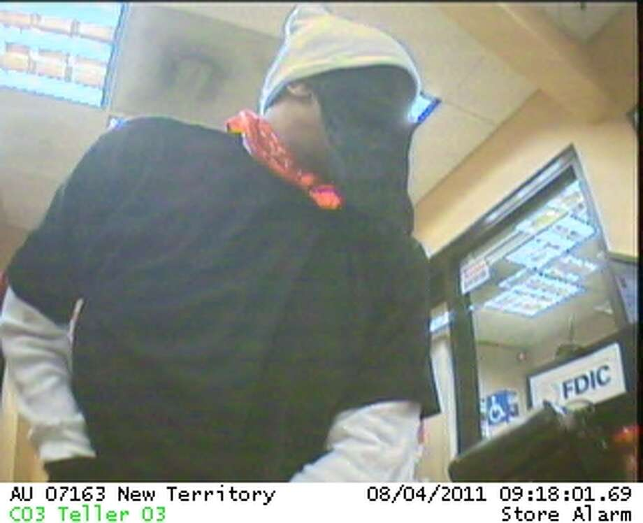 Fort Bend County Sheriff's Office detectives have released five images related to the robbery of  the Wells Fargo Bank located inside the Randalls  in New Territory Thursday,  Aug. 4. The images were captured from surveillance cameras posted at Randalls as well as the bank. / Fort Bend County Sheriff's Offic