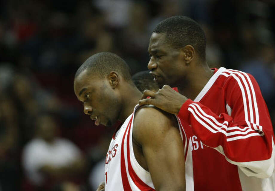 Rockets forward Carl Landry, left, knows he's lucky to be alive after being shot in the leg early Tuesday morning. Photo: Nick De La Torre, Houston Chronicle