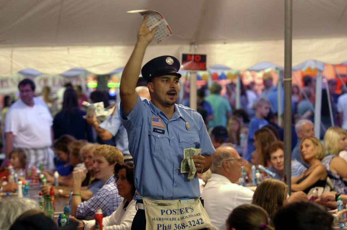 Highlights from the annual Easton Fireman's Carnival in Easton, Conn. on Friday August 5, 2011. Fire fighter Jason Kushnir calls calls for folks to buy a new Bingo card.