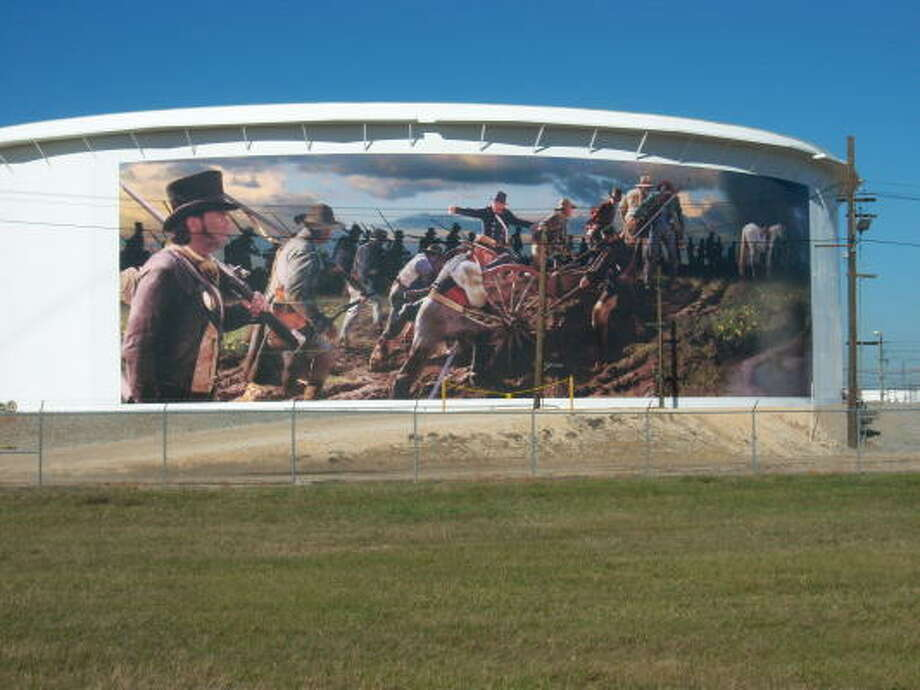 HISTORICAL EVENT: A mural depicting General Sam Houston and a squad of men during the Battle of San Jacinto has been painted onto an oil storage tank near Beltway 8 along Hwy 225.