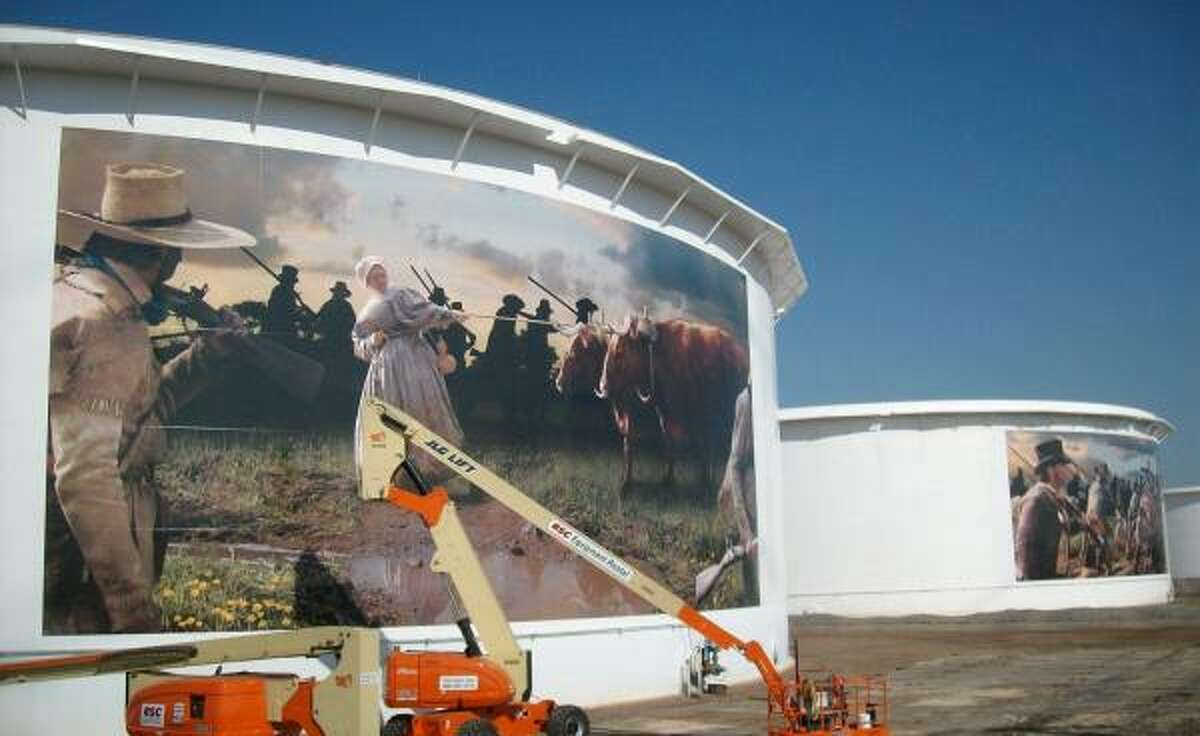 NEW LOOK: A mural of Texian patriot Pamelia Mann before the Battle of San Jacinto has been painted onto an oil storage tank near Beltway 8 along Hwy 225.