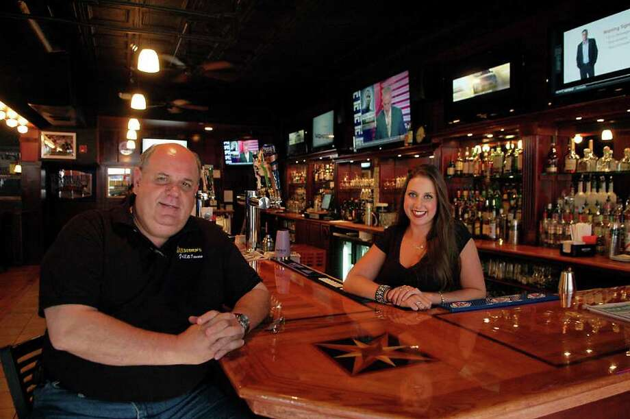 Tony Desjardin Sr., principal owner of Bradford's Grill and Tavern and manager\bartender Shannon Ianni in the bar area of the new establishment at 15 N. Main St., in South Norwalk, Conn. on Thursday Aug. 4, 2011. Photo: Cathy Zuraw / Connecticut Post