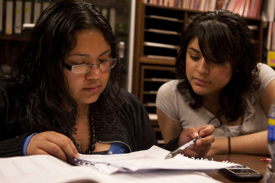 "Eva Briones, left, and Alice Valdez are sophomores at the University of Houston. Seeing others in her family struggle with low-wage jobs has inspired Briones. ""I didn't want to do that,"" she said. Photo: Nathan Lindstrom, For The Chronicle"
