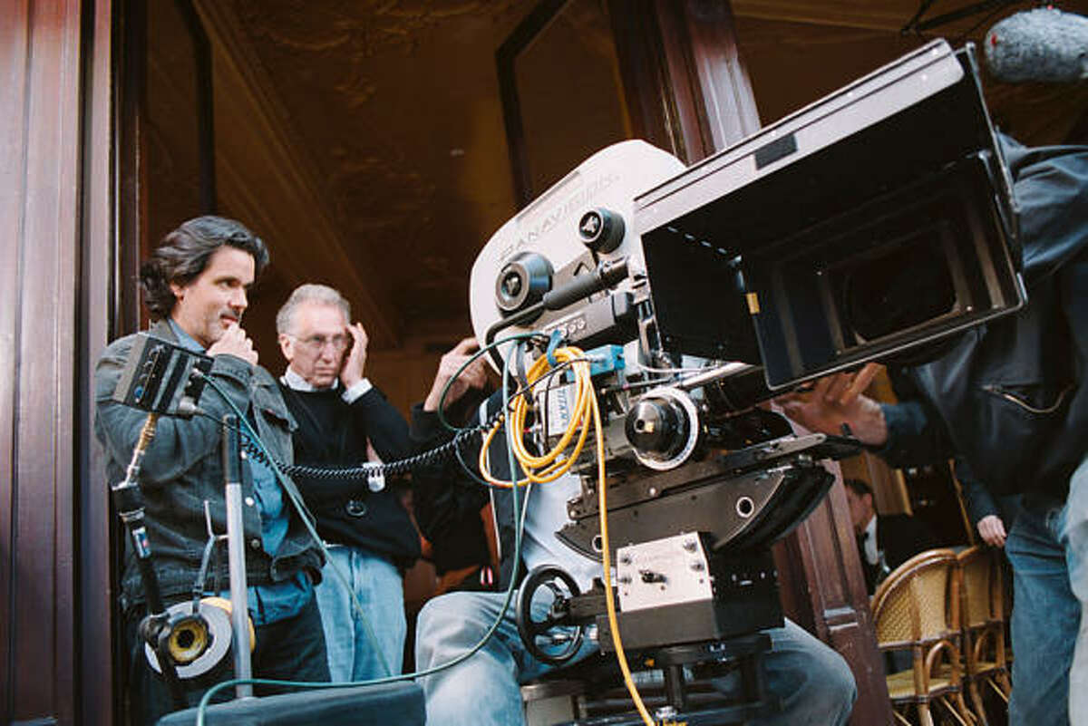 French filmmaker Christophe Barratier, left, and cinematographer Tom Stern, in glasses, shoot Paris 36, opening Friday at the River Oaks Theatre.