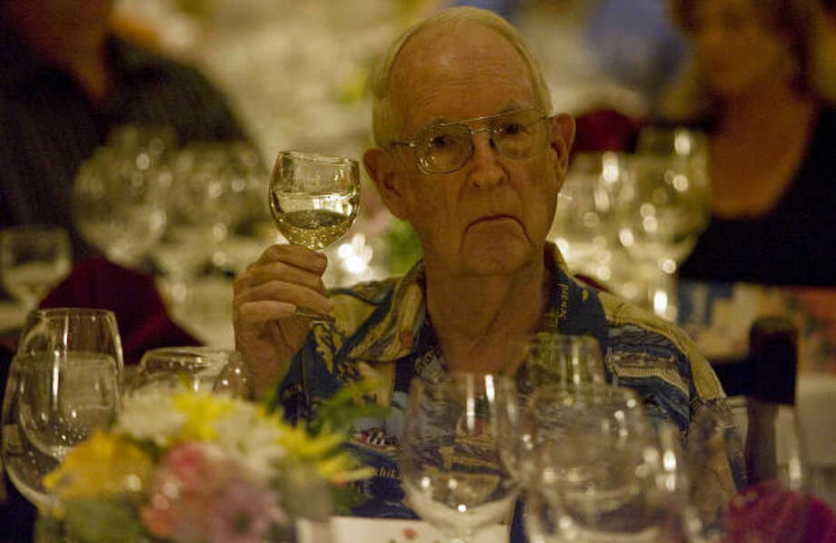 Jim Exum samples a wine during a wine dinner this week at Carmelo's Ristorante, hosted by the Israeli government and Israeli Wine Direct. In the last quarter-century, wine experts have rediscovered Israel. Photo: JAMES NIELSEN :, CHRONICLE