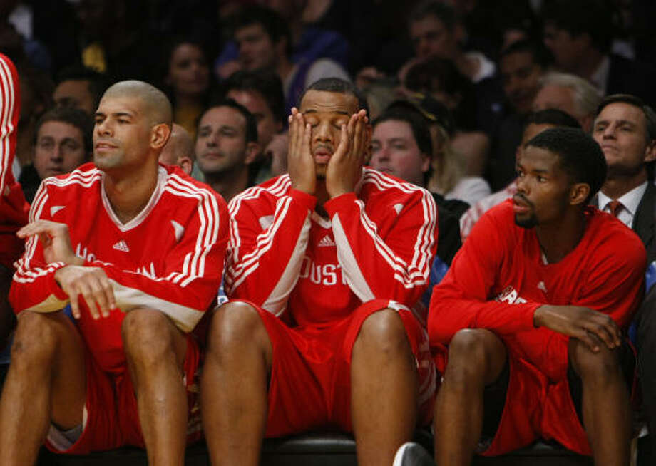 After an inspiring Game 4, Shane Battier, from left, Chuck Hayes and Aaron Brooks struggled for the Rockets in L.A. Photo: Nick De La Torre, Chronicle