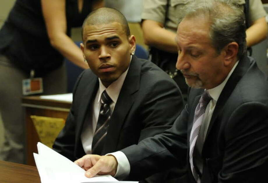 R&B singer Chris Brown (L) sits beside his attorney Mark Geragos (R) at his sentencing at Los Angeles Superior Court on August 5, 2009.   Brown's pleaded guilty in June to a felony assault charge for beating up his ex-girlfriend Rihanna.  The sentencing was continued until August 27. Photo: KEVORK DJANSEZIAN, AFP/Getty Images