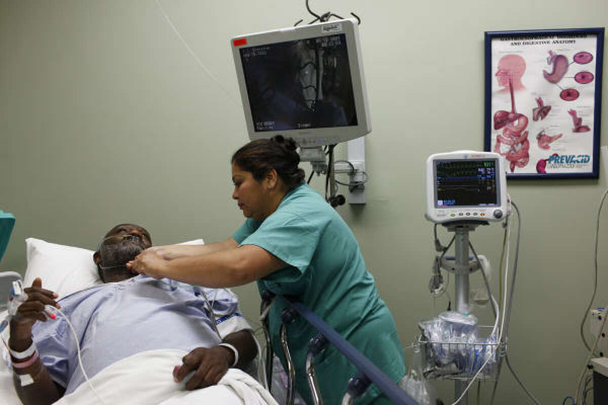 Truthann Rivas, RN, prepares James Everette for a colonoscopy at Audie Murphy VA Hospital in San Antonio on Tuesday, June 16, 2009. The staff takes several time outs to ensure communication. ( Photo by Lisa Krantz / San Antonio Express-News )