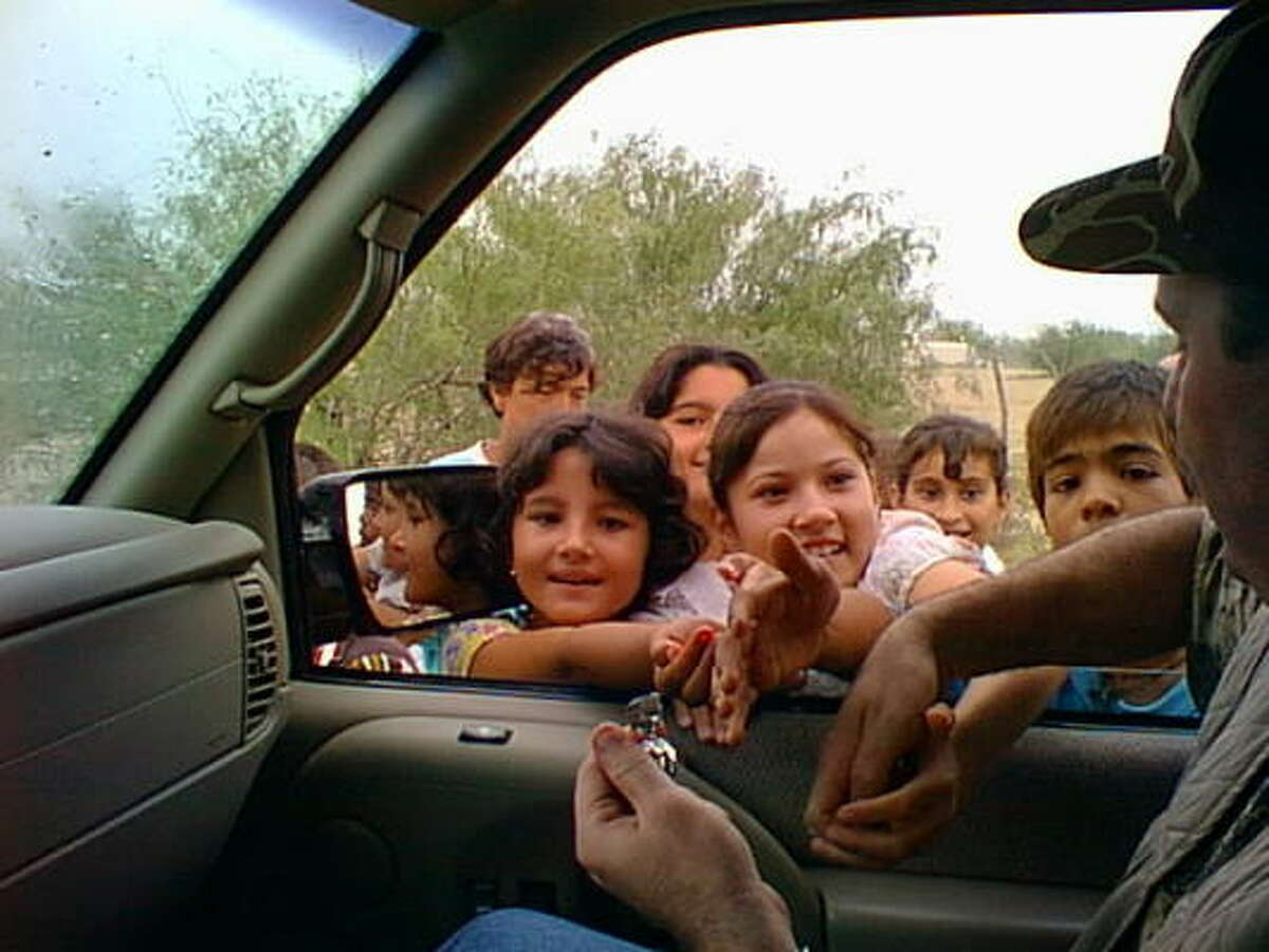 A hunter finds friendlier faces as he passes out candy to children in Villa de Méndez. Visitors have been doing so for years, but last month a resident with an assault rifle warned them not to do it again. The robbery was a few weeks later.