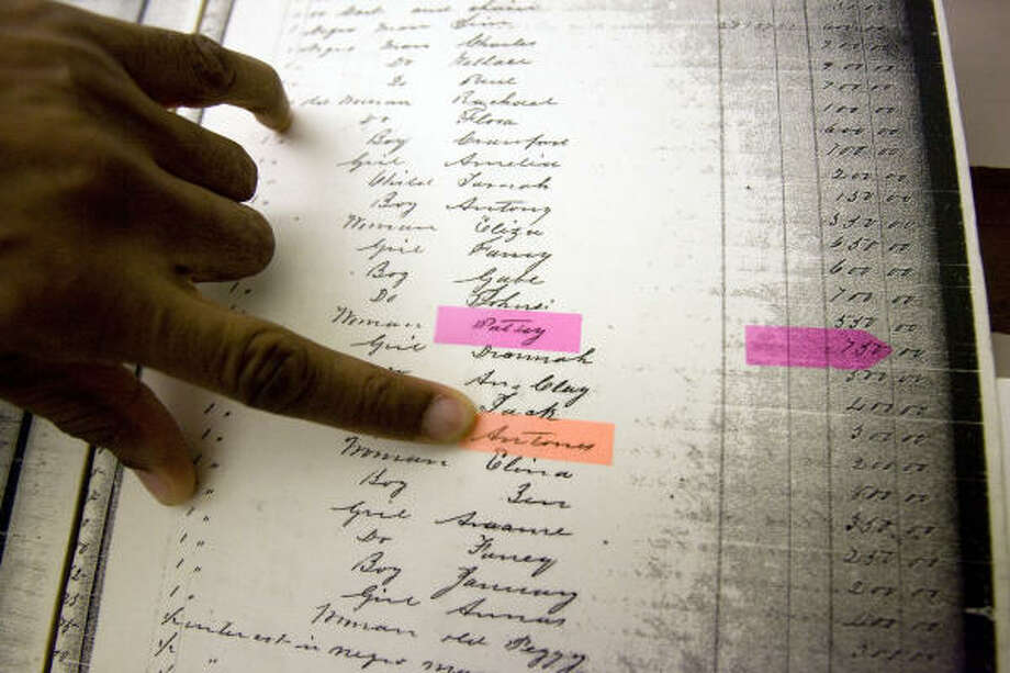 At the Clayton Library, Maurice Allen, Jr., points to a tax list from 1853 listing the value of some of his relatives who were enslaved in Georgia at the time. Photo: Johnny Hanson, Chronicle