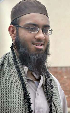 Usman Akhtar, 23, New Fairfield, returned from South Africa, where he studies Islamic Studies, to observe Ramadan with his family. He is standing outside of ... - 628x471