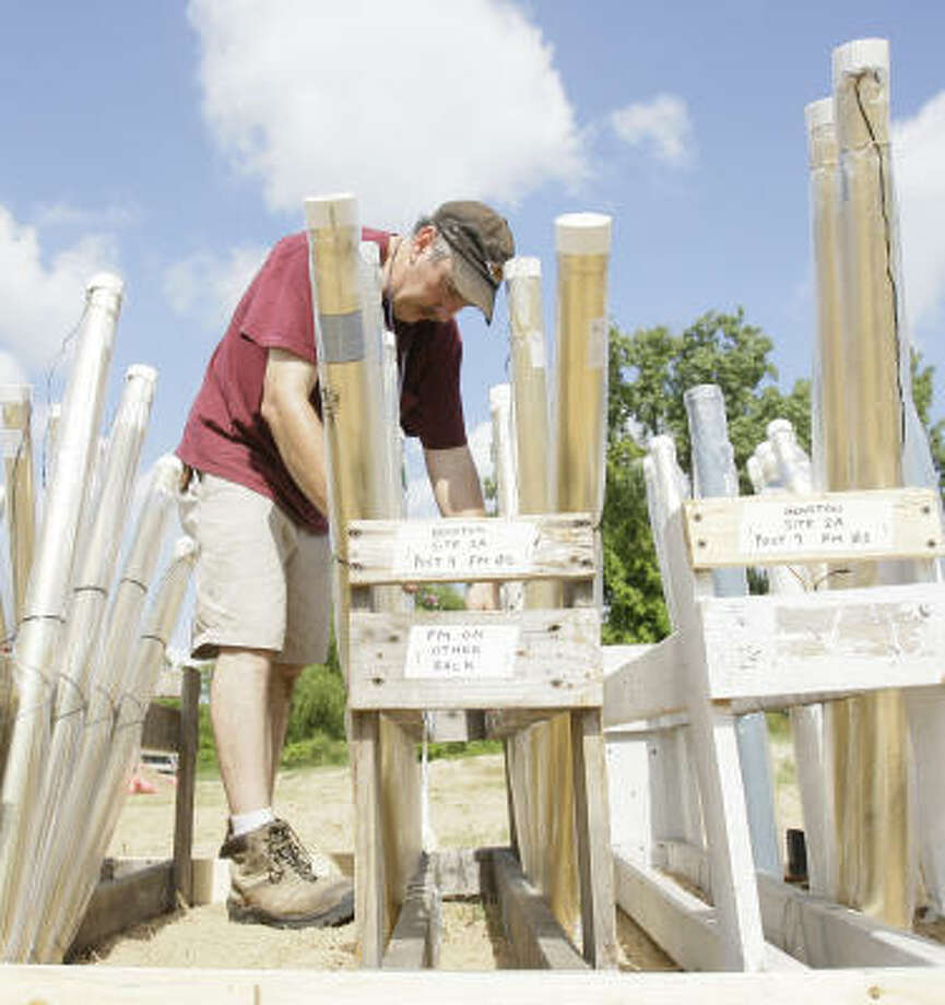 Charlie Johnson of Pyro Spectaculars makes preparations for today's Freedom Over Texas July 4th firework show. Photo: Melissa Phillip, Chronicle