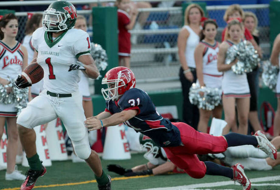Woodlands running back Daniel Lasco runs for a 74-yard touchdown while Clear Lake cornerback brock Groves tries to make the tackle. Photo: Thomas Shea, For The Chronicle