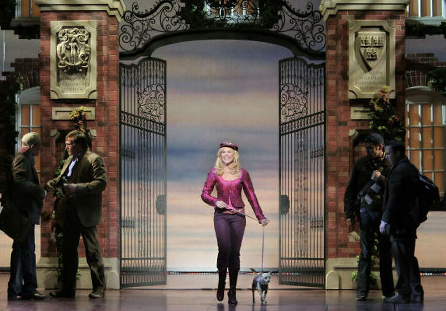 Elle Woods (Laura Bell Bundy) and her pup, Bruiser (Frankie), refuse to let the hallowed halls of Harvard Law School intimidate them in the musical Legally Blonde. Bundy alternates with Lauren Zakrin in the starring role in the Houston stop of the national tour. Photo: Paul Kolnik