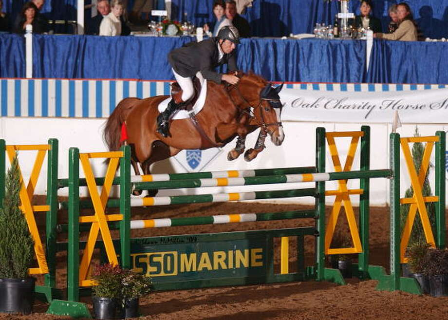 Happy Z was the winning horse at the $30,000 Pin Oak Grand Prix, sending rider Wilhelm Genn to his eighth consecutive victory and 10th overall in the 2009 series. Photo: Pin Oak Charity Horse Show