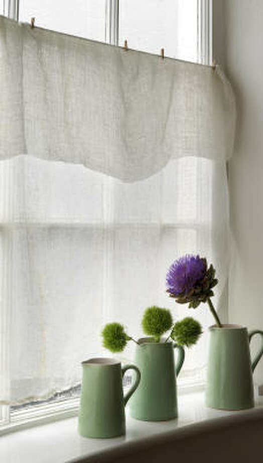 Unbleached muslin is transformed into a cool window treatment in this design from Thrifty Chic by Liz Bauwens and Alexandra Campbell. Photo: Simon Brown, Cico Books