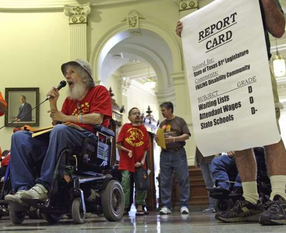 Bob Kafka, the state organizer for Adapt of Texas, speaks during a protest in the Capitol Rotunda on Tuesday on behalf of disabled Texans. Photo: Harry Cabluck, AP