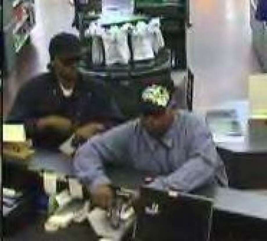 Police are searching for these two men who robbed a southwest Houston bank branch on Tuesday.